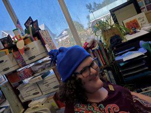 Blue Fleece Hat on Librarian
